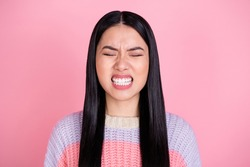 Photo of young unhappy angry mad furious girl having problem grit teeth with close eyes isolated on pink color background