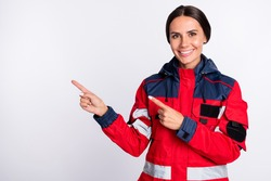 Photo of young woman paramedic happy positive smile indicate fingers empty space ad promo advice isolated over white color background