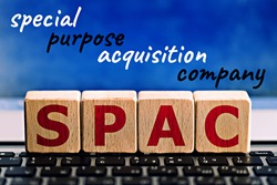 photo on spac (special purpose acquisition company) theme. wooden cubes with the abbreviation