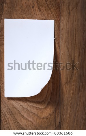 Photo paper attach wooden background with curved edge