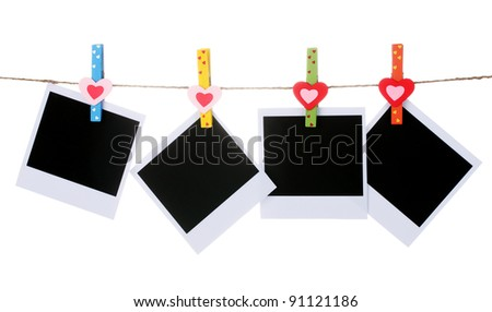 Photo paper hanging on the clothesline isolated on white - stock photo