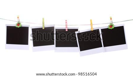 Photo paper hanging on the clothesline isolated on white