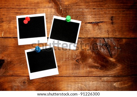 Photo papers on wooden background