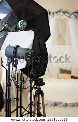 Photo photographic studio with modern lighting equipment. Empty space for your text or objects. clous up