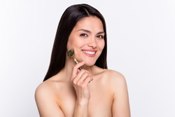 Photo portrait brunette woman doing face massage with jade smiling isolated white color background