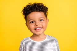 Photo portrait cheerful small boy smiling in striped shirt isolated bright yellow color background