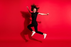 Photo portrait full body view of crazy girl jumping up isolated on vivid red colored background