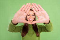 Photo portrait happy woman showing border triangle with palms isolated pastel green color background