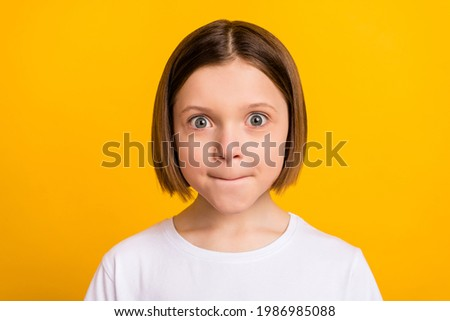 Photo portrait little girl with bob hairdress staring amazed in casual outfit isolated vivid yellow color background Stockfoto ©