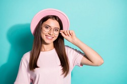 Photo portrait of adorable pretty woman girl wear vintage cap arm touching glasses isolated turquoise color background