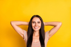 Photo portrait of cheerful woman chilling on the break wearing striped t-shirt isolated on bright yellow color background