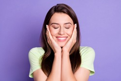 Photo portrait of curious dreamy girl touching cheeks with closed eyes smiling isolated on vivid violet color background