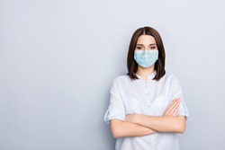 Photo portrait of girl with crossed arms wearing blue face mask isolated on white colored background with blank space