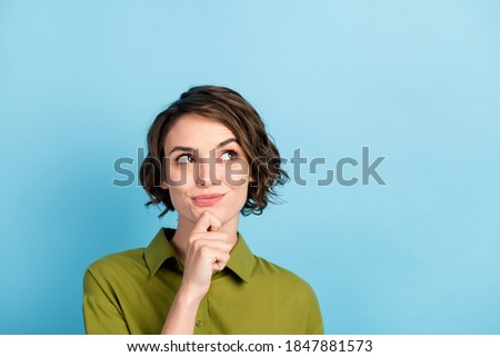Photo portrait of nice girl having new idea trying to find solution dreaming looking up having a plan isolated on blue color background with copyspace