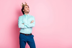 Photo portrait of proud prince with crossed arms looking at blank space isolated on pastel pink colored background