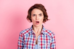 Photo portrait of upset woman with open mouth isolated on pastel pink colored background