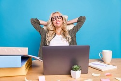 Photo portrait woman sitting in office having break dreaming about vacation smiling isolated pastel blue color background