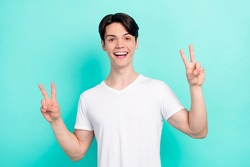 Photo portrait young guy wearing white t-shirt showing v-sign gesture isolated bright teal color background