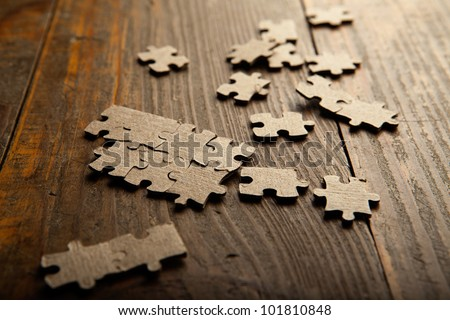 Photo puzzles scattered brown paper on the floor of wooden planks