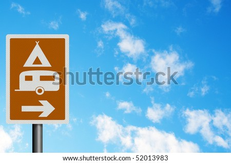 Photo realistic metallic 'caravan and camping site' tourist information sign against a bright blue sky. With space for your text / editorial overlay