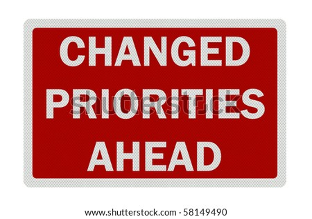 Photo realistic metallic reflective 'change in priorities' sign, isolated on pure white. Business / political metaphor