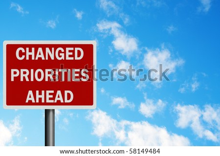 Photo realistic metallic reflective 'changed priorities' sign, with space for your text / editorial overlay. Business / political concept