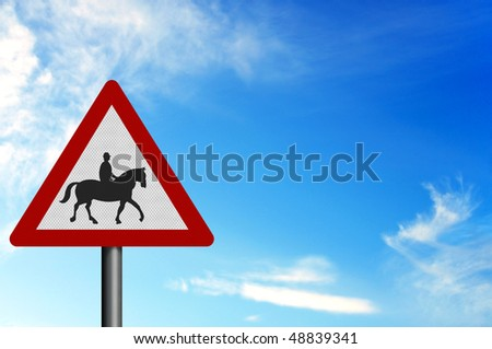 Photo realistic metallic reflective 'horses with riders' sign, against a bright blue sky. With space for your text overlay / editorial