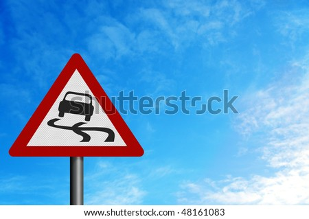 Photo realistic reflective metallic 'slippery road' sign, against a bright blue sky.