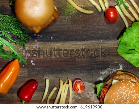 Photo retro background set with french fries and burgers on a dark background #619619900