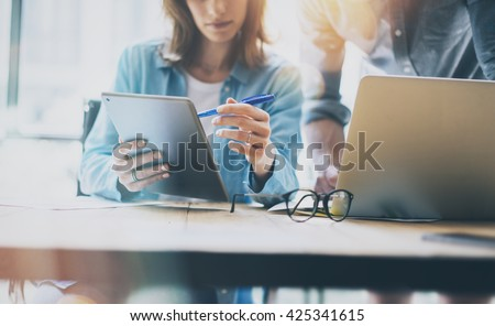Photo Sales Manager Working Modern Office.Bearded Man Use Generic Design Laptop.Account Department Work New Startup Project.Researching Process at Wood Table.Horizontal.Burred Background.Film effect