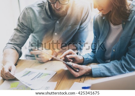 Photo Sales Manager Working Modern Studio.Woman Showing Market Report Digital Tablet.Account Department Work New Startup Project.Researching Process Wood Table.Horizontal.Burred Background.Film effect