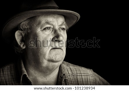 photo senior male retired wearing a hat on black