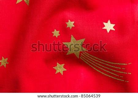 photo shot of stars on red fabric
