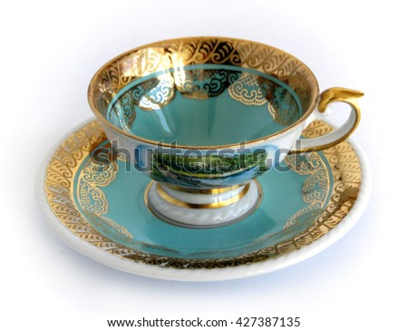 Photo shows an empty antique porcelain cup and saucer