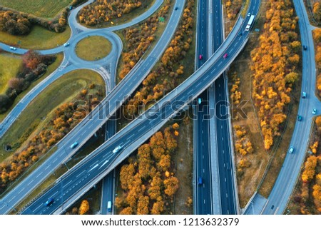 Photo shows multiple motorways in an autumn morning. Photo taken with drone.