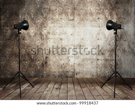 photo studio in old grunge interior with retro wallpaper - stock photo