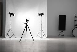 Photo studio interior with set of professional equipment