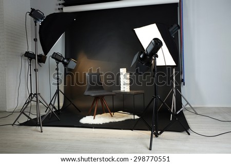Photo studio with modern interior and lighting equipment