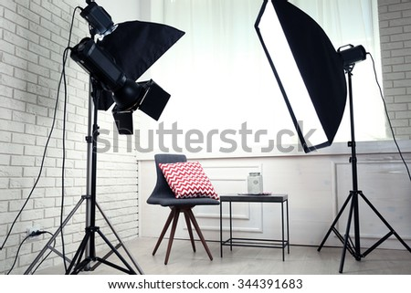 Photo studio with modern interior and lighting equipment #344391683