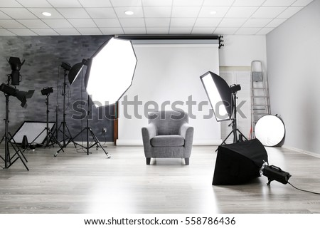 Photo studio with modern interior and lighting equipment #558786436