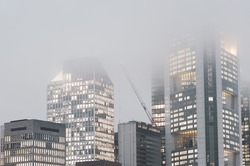 Photo stylised by old with grain: skyscrapers of the Frankfurt city centre by fog