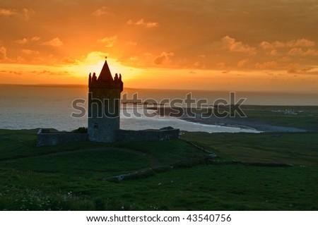 photo sunset capture of a old irish castle on west coast of ireland
