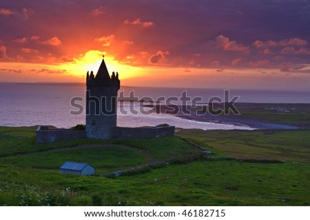 photo sunset of a ancient castle in the west coast of ireland