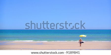 Photo taken at Henley Beach featuring a yellow umbrella and old man (Adelaide, South Australia).