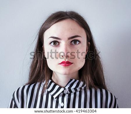 photo teen girl red lipstick striped shirt #419463304