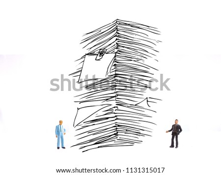 photo two mini figure businessman with sketchy stack of papers or report at white background