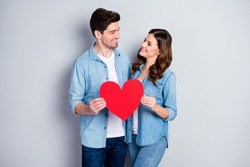 Photo two people charming lady handsome guy demonstrating per paper heart figure postcard symbolizing love wear casual denim shirts outfit isolated grey color background
