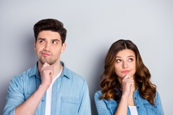 Photo two people lady handsome guy couple look up empty space doubtful situation who is right wrong wear casual denim shirts outfit clothes isolated grey color background