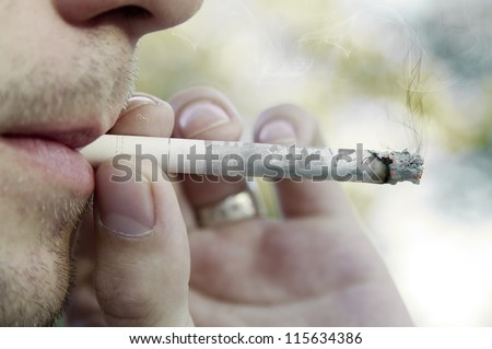 Photo where the man smoking a cigarette with the pictures of his life