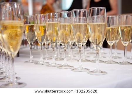 photo with glasses of champagne on festive table